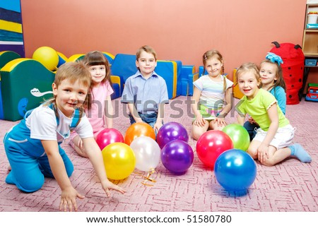 A group of preschool kids in kindergarten - stock photo