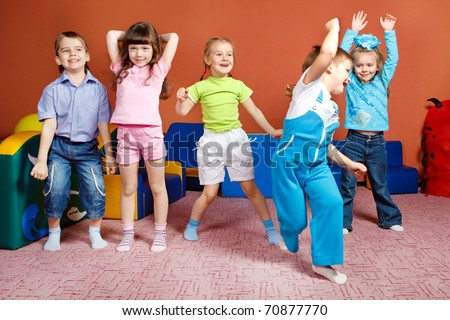 A group of preschool kids in kindergarten - stock photo