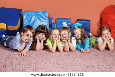 A group of preschool kids on the floor - stock photo