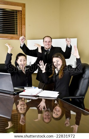 A group of professionals excited about a new development - stock photo