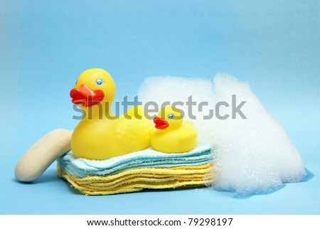 A group of rubber duckies and other bathing items come together to conceptualize a juveniles bath time. - stock photo