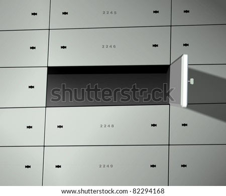 A group of safe deposit boxes and one of  the boxes is wide open / Safe deposit box