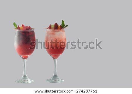 A group of Sangria drinks with condiments