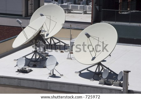 A group of satellite dishes point skyward.