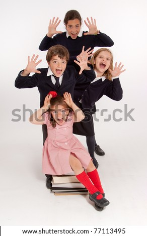 A group of schoolchildren with panic expressions - stock photo