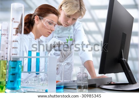 a group of scientists working at the laboratory - stock photo