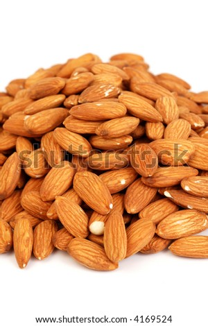 A group of shelled almond nuts on a white background.