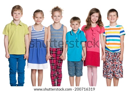 A group of six fashion children are standing together on the white background