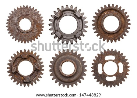 A group of six rusty transmission gears isolated on a white background. - stock photo