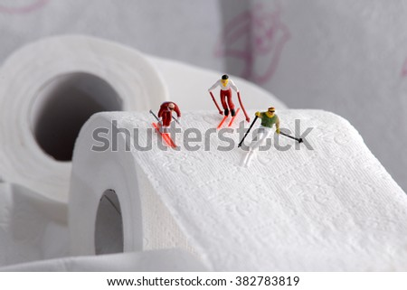 A group of small people going down on skis. concept of sport - stock photo
