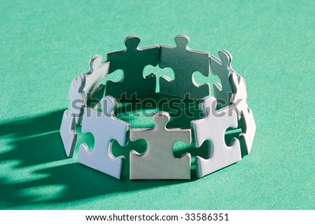 A group of small upright jigsaw puzzle pieces - stock photo