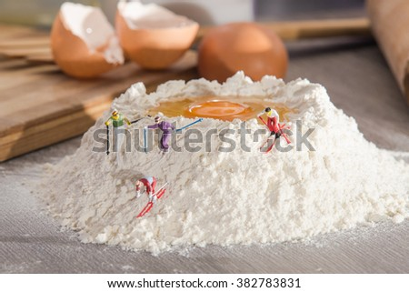 A group of small young people going down on skis. concept of sport and cooking - stock photo