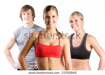 A group of smiling friends in athletic clothing, midrifts exposed. - stock photo