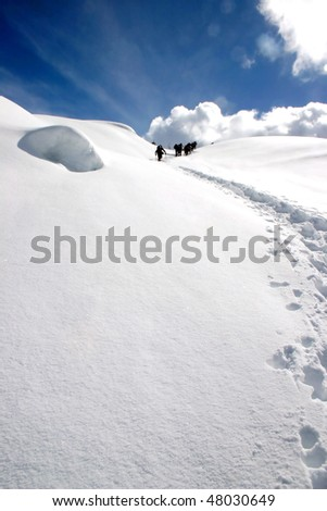 A group of snow shoe hiker arrived snow peak near Whistler, BC, Canada. - stock photo
