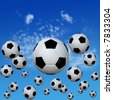 A group of soccer footballs kick into a high cloud blue sky. 3D illustration. - stock photo