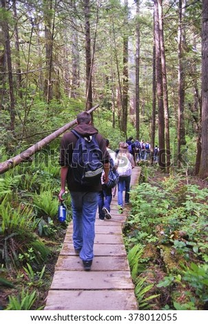 A group of students hiking on a school trip in Washington. - stock photo