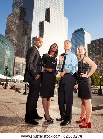 A group of successful busienss people looking up and to the side - concept image of success or dreams - stock photo
