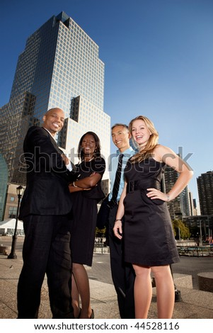A group of successful business people downtown - stock photo