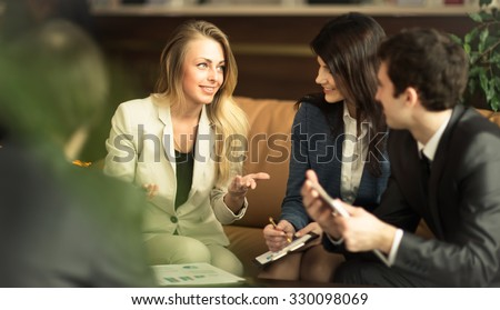 A group of successful businessmen. Discussion of the important contract of the company. - stock photo