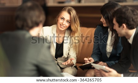 A group of successful businessmen. Discussion of the important contract of the company.