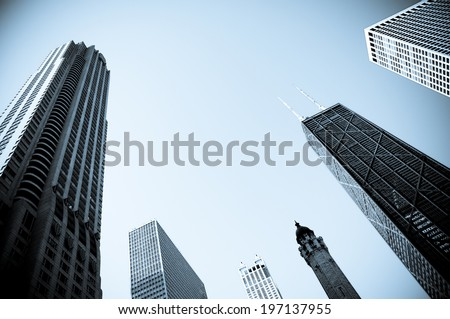 A group of tall buildings in the city. - stock photo