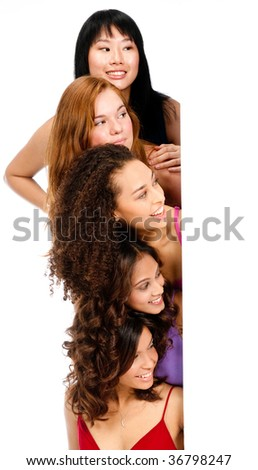 A group of teenagers with diverse ethnicities looking at a blank space against white background - stock photo