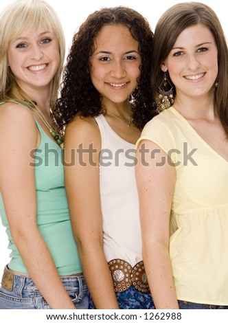 A group of three attractive young women standing close together