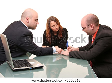 A group of three signing a contract. Isolated on a white background - stock photo