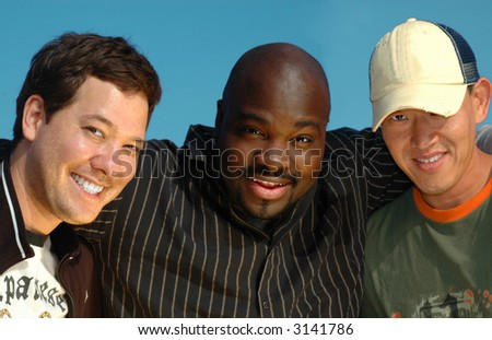 A group of three young college students on spring break - stock photo