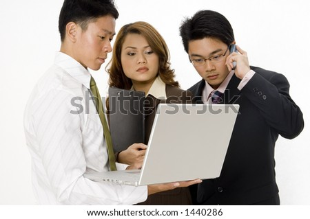 A group of three young professionals have an impromptu business meeting - stock photo