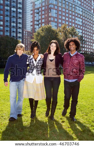 A group of university students infront of a large building - stock photo