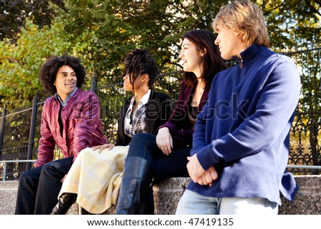 A group of university students visiting and having fun - stock photo