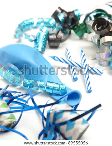 A group of various blue party supplies on a white background. - stock photo