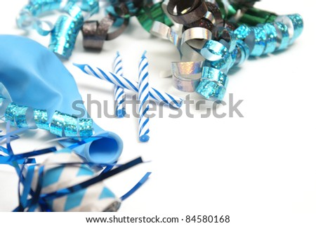 A group of various blue party supplies on a white background with plenty of copyspace. - stock photo