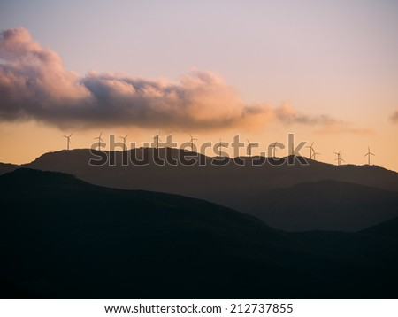 A group of Wind Generators at the top of a hill. Cap Corse, Corsica, France, Europe. - stock photo