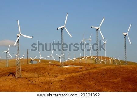 A group of windmills on Altamont Pass, California, USA - stock photo