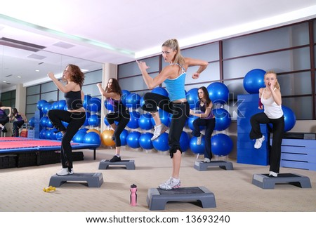 A group of women exercising in the fitness club. - stock photo