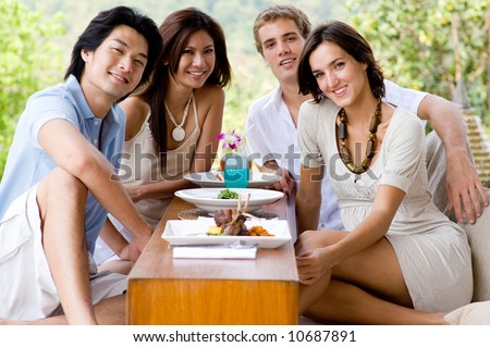 A group of young adults having lunch on vacation