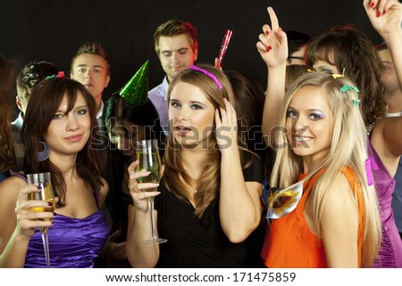 A group of young beautiful people dancing at a disco - stock photo
