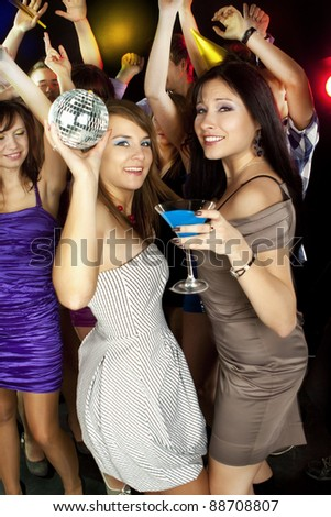 A group of young beautiful people dancing at New Year party - stock photo