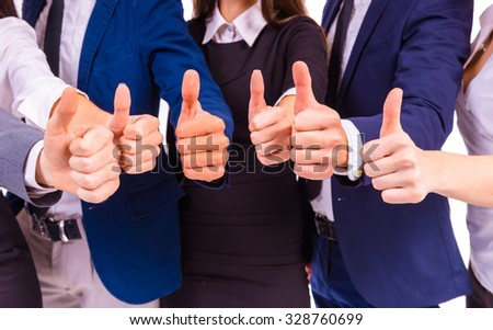 A group of young business people smiling on a white background. Studio shooting - stock photo
