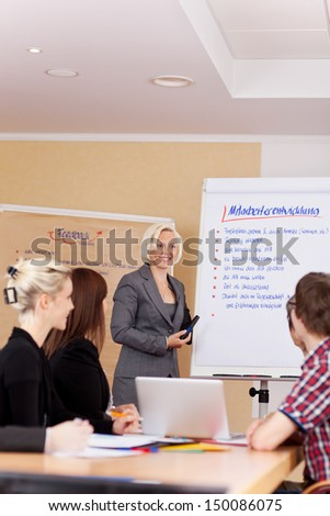a group of young employees sitting in a seminar - stock photo
