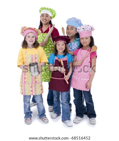 A group of young girls preparing to cook something - stock photo