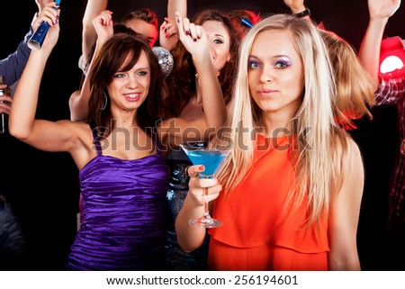 A group of young people dancing at night club. - stock photo