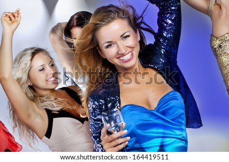 A group of young people dancing at night club. New Year party