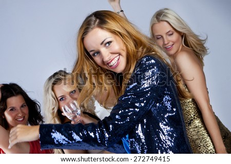 A group of young people dancing at night club. New Year party - stock photo