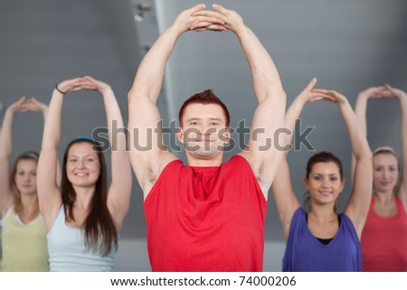 A group of young people in aerobics class