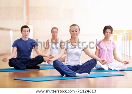 A group of young people in the lotus position - stock photo