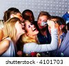 A group of young people singing at a karaoke. - stock photo