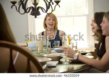 A group of young women eating lunch in a well-lit dining room